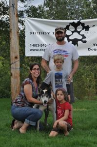 Here Gus is with his adoptive family!